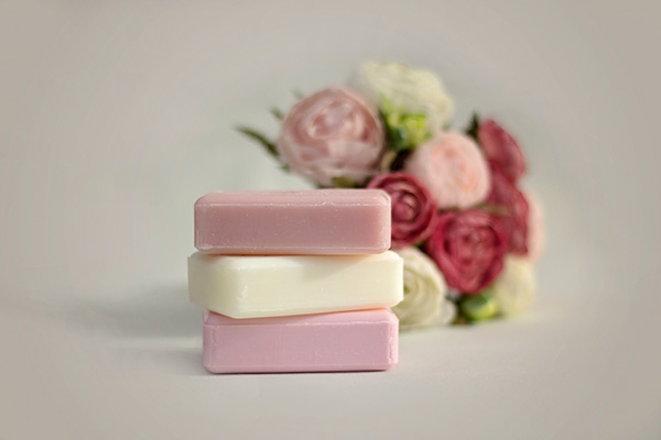 Rose Pink Soap in front of Bouquet of Flowers